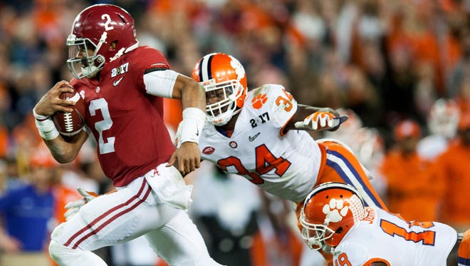 Alabama quarterback Jalen Hurts (2) would've scored the game-winning touchdown had Deshaun Watson not led Clemson to a comeback win in the College Football Playoff title game's final seconds.