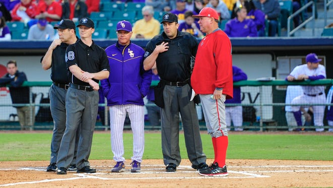 UL baseball coach Tony Robichaux (right) and LSU baseball coach Paul Mainieri (center) are shown with the umpires during the 2017 Wally Pontiff Jr. Classic.