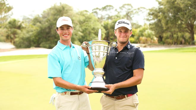 Garrett Barber, right, and Cole Hammer hold the trophy after winning the final round of the 2018 U.S. Amateur Four-Ball at Jupiter Hills Club in Tequesta on Wednesday, May 23, 2018.