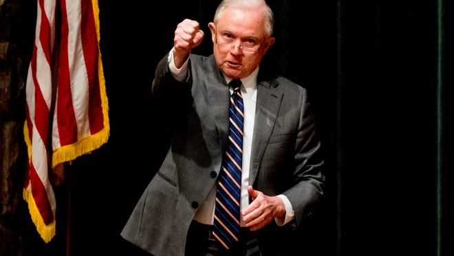Attorney General Jeff Sessionspumps his fist to the crowd at the Law Enforcement Training Conference at the Gatlinburg Convention Center in Gatlinburg, Tennessee on Tuesday, May 8, 2018.