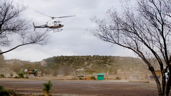 The GRMC helicopter lands at Guadalupe Montessori School on Friday.