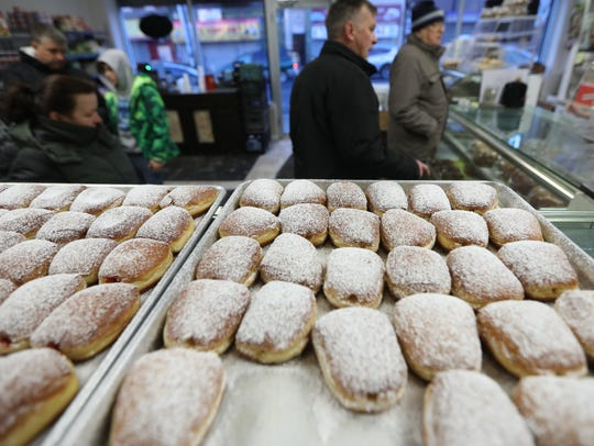 Customers crowd into Polonia Bakery, in Passaic, just