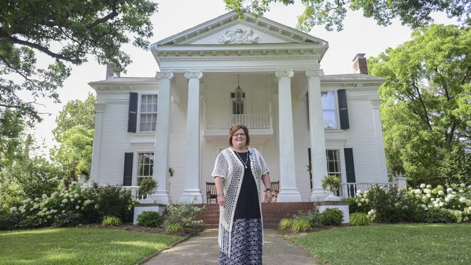 Terrie Hopper, co-wner of Twin Oaks with her husband, stands in front of the historic home in Humboldt which they opened in 2012 to the public. Hopper said she has booked about 30 weddings this year, her highest number yet, in the home that was finished in 1860.