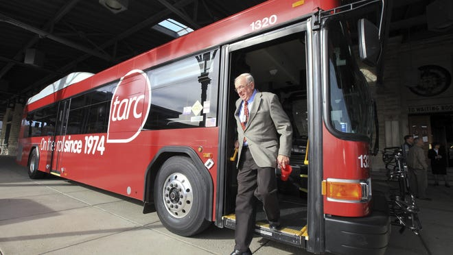 Michael Clevenger/The Courier-JournalJohn Brenzel exits a bus in November painted to mark TARC's 40th anniversary. With the new fare system, cash will be accepted but drivers will no longer give out paper transfers. 2014 photo by Michael Clevenger/The C-jTARC is hoping to save $1.2 million a year by cutting three routes starting in August. John Brenzel steps off of a specially painted bus that marks TARC's 40th Anniversary.November 10, 2014