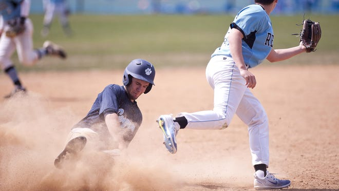 Mount Mansfield's Kyle Leggett, left, slides into third base for a steal as the throw from home sails past South Burlington third baseman Jack Ambrosino during Saturday's baseball game in South Burlington.