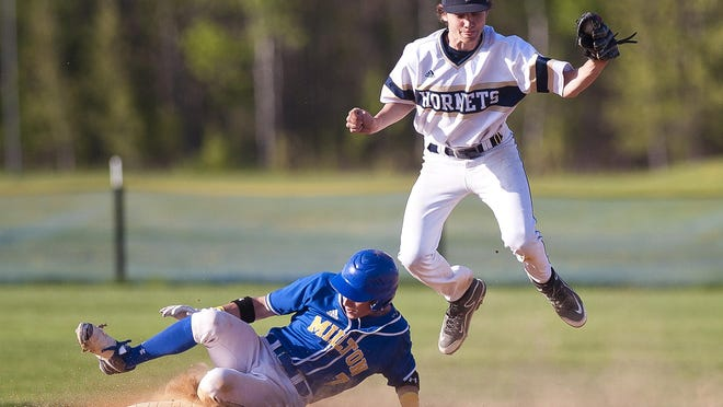 Essex shortstop Edgar Koval catches a throw at second base as he leaps over the slide of Milton's Ian Hrynyszyn during last week's high school baseball game in Essex.