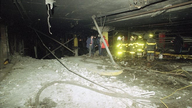 Firemen and officials examine the underground parking garage after a massive explosion in the World Trade Center in New York City on Friday, Feb. 26, 1993. The noontime blast, which rocked the twin towers complex, killed six people and injured over 1,000 others.