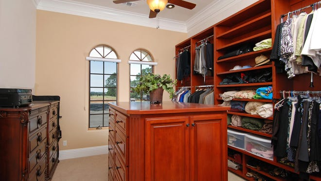 A guest bedroom can be converted to a spacious walk-in closet.