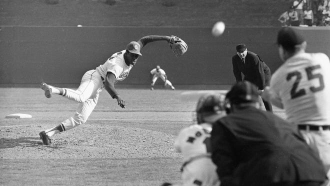 FILE - In this Oct. 2, 1968, file photo, St. Louis Cardinals pitcher Bob Gibson throws to Detroit Tigers' Norm Cash in the ninth inning of the opening game of the World Series in St. Louis. Gibson struck Cash out for the 16th strikeout of the game and set a new World Series record. Looking on are catcher Tim McCarver, home plate umpire Tom Gorman and first base umpire Jim Honochick. On Thursday, Nov. 13, 2014, Clayton Kershaw became the first pitcher since Gibson in 1968 to win the National League MVP award. (AP Photo/ File)