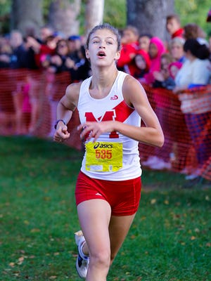 Alena Sapienza-Wright wins the girls 5K during the Rumble in the Jungle race. September 13, 2014