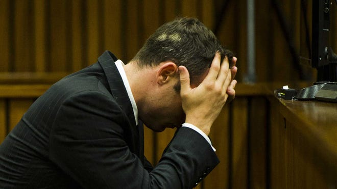Oscar Pistorius listens to evidence at court in Pretoria, South Africa, on March 13.