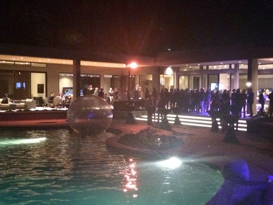 People mingle and enjoy cocktails at a private home in Rancho Mirage for the Fashion Week El Paseo kick off party, held Thursday night.