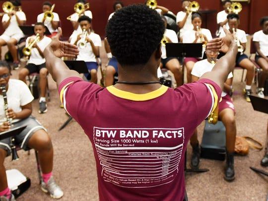 Emmanuel Hudson teaches band camp at  Booker T. Washington