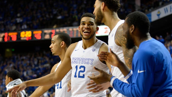 Kentucky's Karl-Anthony Towns celebrates on the bench wiht Willie Cauley-Stein during the second half at Rupp Arena in Lexington.(February 21, 2015)