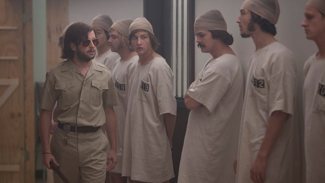 An antagonistic guard (left, Michael Angarano) oversees faux inmates in the drama 'The Stanford Prison Experiment,' drawn from a real-life 1971 event.