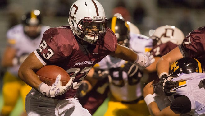 Dowling's Jacob Zachary carries the ball during Monday night's Class 4A football game at Williams Stadium in Des Moines, Monday, Nov. 2, 2015.
