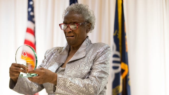 Rosa Wims reacts as she is handed her Lifetime Achievement Award at the Human Service Worker of the Year Awards Luncheon at the Rochester Riverside Convention Center on Friday, November 6, 2015.