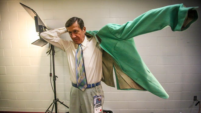Sager puts on his green jacket before heading out to the court to work. He has been known through the years for his brightly colored jackets and ties and let's not forget the shoes. Craig Sager, the eccentric TNT/TBS NBA sideline reporter began his broadcast career with WINK-TV in Fort Myers in the mid-1970s. HeÕs now renewing his very public battle against leukemia while still working NBA games. He worked the Chicago Bulls at Miami Heat game on Thursday, April 7, 2016.