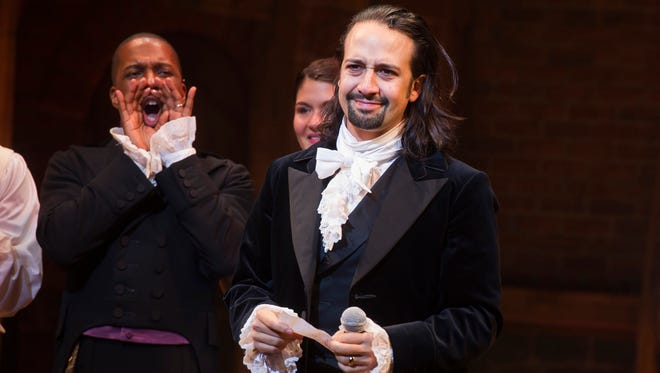 "In this Aug. 6 photo, Lin-Manuel Miranda appears at the curtain call following the opening-night performance of ""Hamilton"" at the Richard Rodgers Theatre in New York."