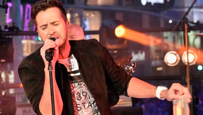Luke Bryan performs on stage during New Year's Eve celebrations at Times Square on December 31, 2015 in New York City.