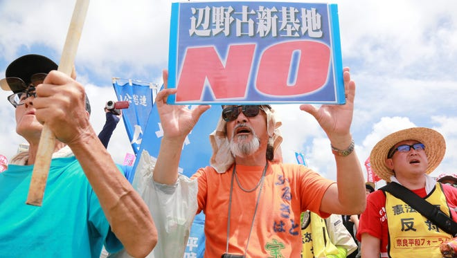 Protesters take part in a demonstration in Naha, Okinawa island, southern Japan, on May 15, 2016, to protest against the construction of a U.S. Marine Corps air base in Nago's Henoko district.