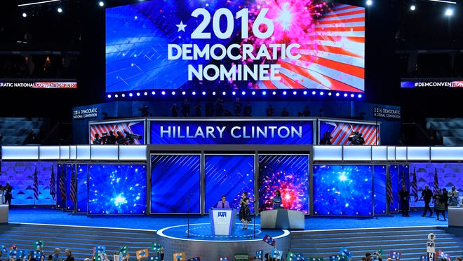 A sign declaring Hillary Clinton the official Democratic nominee appears during the Democratic National Convention at Wells Fargo Arena in Philadelphia on July 26, 2016.