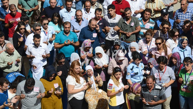People pray in memory of the victims of a bombing blamed on Kurdistan Workers' Party (PKK) during a funeral in Diyarbakir, southeastern Turkey, on August 16, 2016.