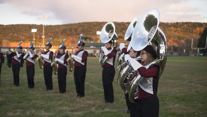 Members of the Central Square Redhawk Regiment practice before the start of the 2015 Golden Circle of Bands competition in Vestal.