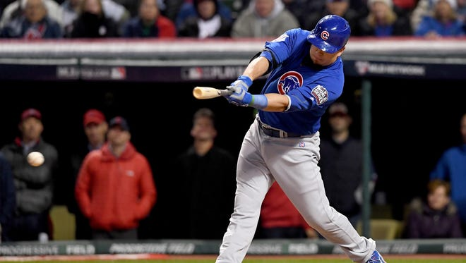 Kyle Schwarber of the Chicago Cubs hits an RBI single to score Ben Zobrist #18 during the fifth inning against the Cleveland Indians in Game Two of the 2016 World Series at Progressive Field.