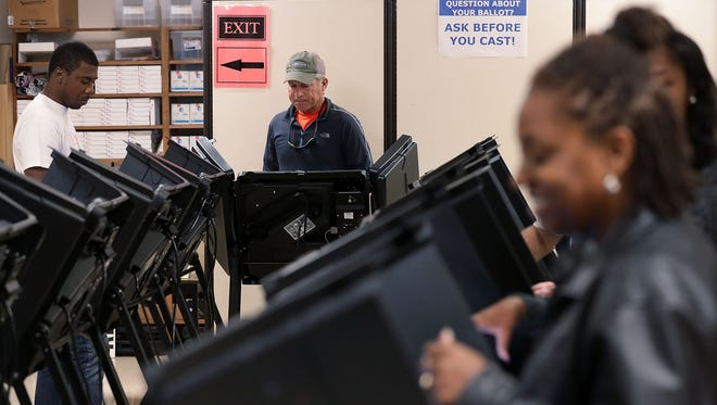 Voters cast their ballots during early voting for the 2016 general election at Forsyth County Government Center Oct. 28 in Winston-Salem, North Carolina.