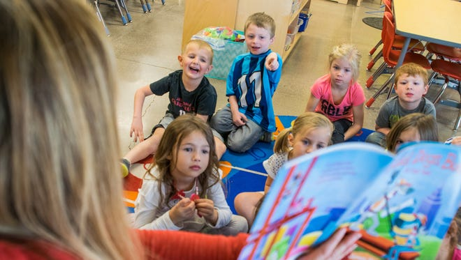 """Students listen to Susie Markosian read them a story at Sue Sossaman Early Childhood Development Center in Queen Creek on Feb. 15, 2017. Sossaman is one of the Higley Unified School District schools adding a """"highly gifted"""" program to its existing specialized preschool lineup for the 2017-18 school year."""