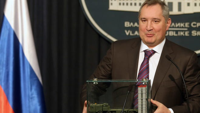"""FILE - In this Monday, Jan. 11, 2016 file photo, Russian Deputy Prime Minister Dmitry Rogozin holds a model of an S-300 surface-to-air missile system at a news conference in Belgrade, Serbia. In May 2015, Rogozin invoked the X-37B unmanned space plane as evidence that his country's space program was faltering. """"The United States is pushing ahead,"""" he warned Russian lawmakers. Less than two weeks later, the hacking group Fancy Bear tried to penetrate the Gmail account of a senior engineer on the X-37B project at Boeing."""