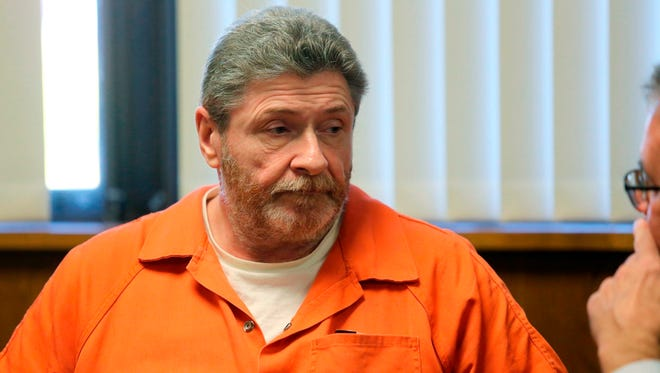 In this Nov. 7, 2016, photo, Charles Pickett Jr., arrives for a preliminary examination before Judge Vincent Westra in Kalamazoo County District Court in Kalamazoo, Mich.