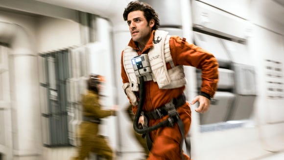 "Seen here in ""Star Wars: The Last Jedi,"" Oscar Isaac will reprise his role as flyboy Poe Dameron in the this fall's animated series ""Star Wars Resistance"" as well as next year's finale to the Skywalker saga, ""Episode IX."""