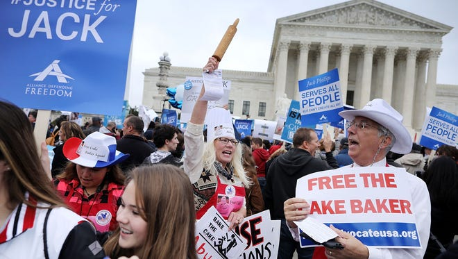 Demonstrators protested outside the Supreme Court in December when Colorado baker Jack Phillips' appeal was heard.