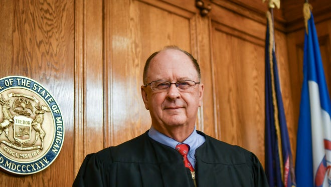 Ingham County Judge William Collette pictured in his courtroom Wednesday, June 27, 2018, his last full day of service.  Collette has been a judge since 1979.