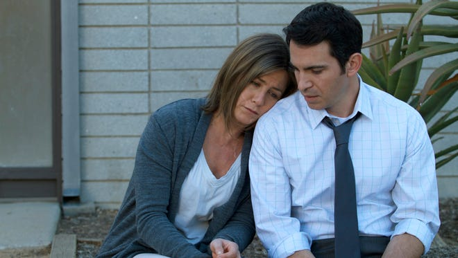 "Jennifer Aniston (L) and Chris Messina in a scene from ""Cake."""