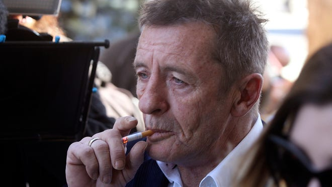 In this Thursday, July 9, 2015, photo, former AC/DC drummer Phil Rudd arrives for sentencing at the Tauranga District Court in Tauranga, New Zealand.