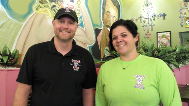 Manager Ryan Fallon and Assistant Manager Allison Gossett at the Palm Coast location of Cantina Louie welcomed guests to the new location in June.