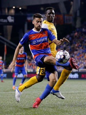 FC Cincinnati midfielder Nazmi Albadawi (5) kicks away from Nashville SC midfielder Bolu Akinyode (30) in the second half of the USL soccer match between the FC Cincinnati and the Nashville SC at Nippert Stadium in Cincinnati on Saturday, Aug. 4, 2018. FC Cincinnati gave up a late goal and settled for a 1-1 tie against Nashville.