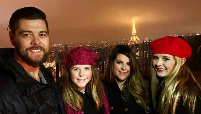Christian singer Jason Crabb; his wife, Shellye; and their daughters, Emma and Ashleigh, visit the Eiffel Tower in Paris.