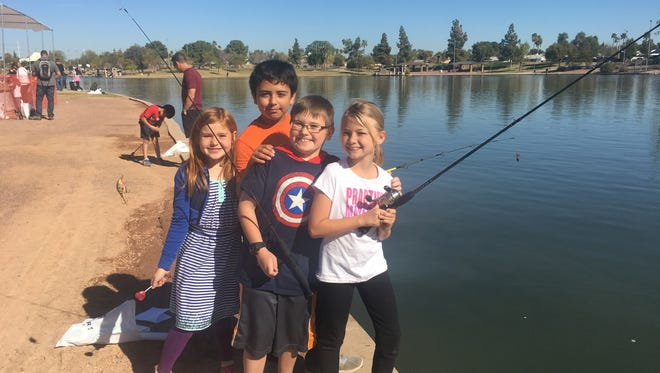 Kids and families gathered in Tempe at Kiwanis Lake on Feb. 25, 2017, for a day of free fishing.