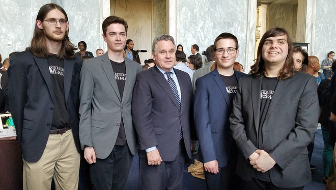 Photos of winning students with Representative Chris Smith