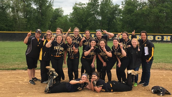 Taylor High School's softball team celebrates winning the first Cincinnati Hills League title since 2004. The Yellow Jackets clinched on May 1, 2017.