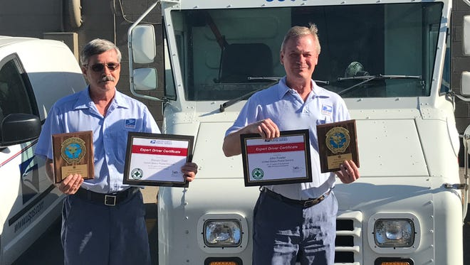 """Ron Deer (left) and John Fowler (right)were recognized as """"million milers,"""" for either one million miles of driving or 30 years of driving without a preventable accident."""