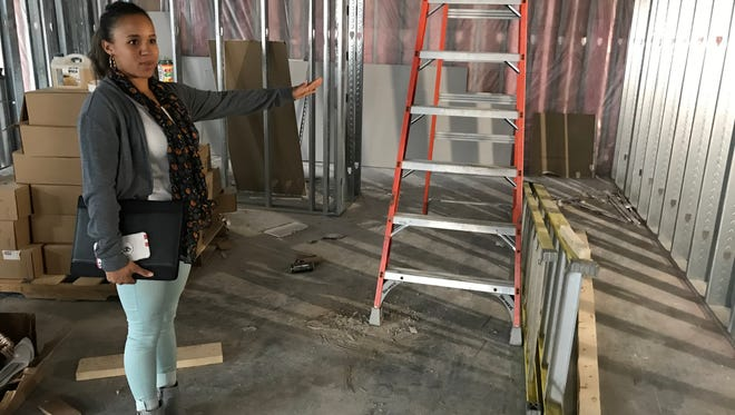 Inkka Beaudion, owner of Swamp Daddy's Cajun Kitchen, gives a tour of the construction at her new restaurant space. The location is scheduled to open early 2018.