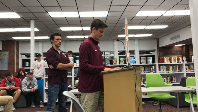 Verona High School quarterback Tom Sharkey speaks in support of his coach, Lou Racioppe, who was recently relieved of his duties.