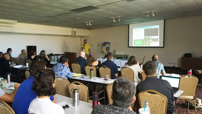 Presenter Shane Siers speaks about the effect of aerial baiting on the brown tree snake population during a technical working group meeting at Top o' the Mar, Nimitz Hill on Nov. 15, 2017.