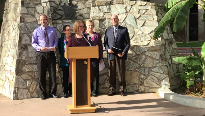Arizona Rep. Heather Carter (center) was joined by (from left) Alzheimer's Association Program and Advocacy Director James Fitzpatrick, Teresa Webb, state Sen. Kate Brophy McGee, and Dr. David Coon at a press conference about awareness of Alzheimer's disease during the holidays.