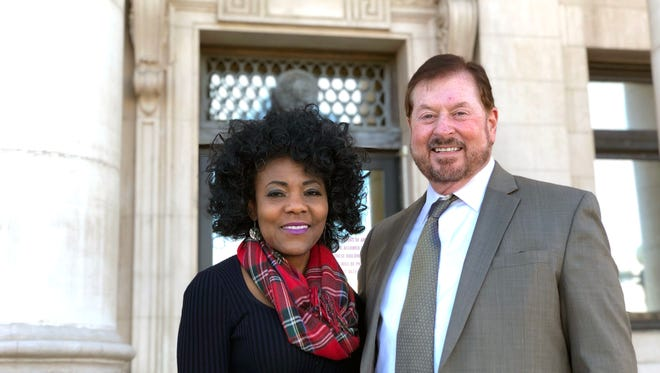 Vickie and Jeff Francovich pose in front of Washoe County Courthouse after winning their adverse possession case to take ownership over 110 Mark Twain Avenue, March 5, 2018. The house was abandoned for five years and they used a Nevada property law to take possession by paying taxes and repairing the house.